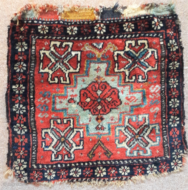Sweet tribal bagface, graphically strong, some losses to bottom, but great wool, and good colours 17in by 18in
