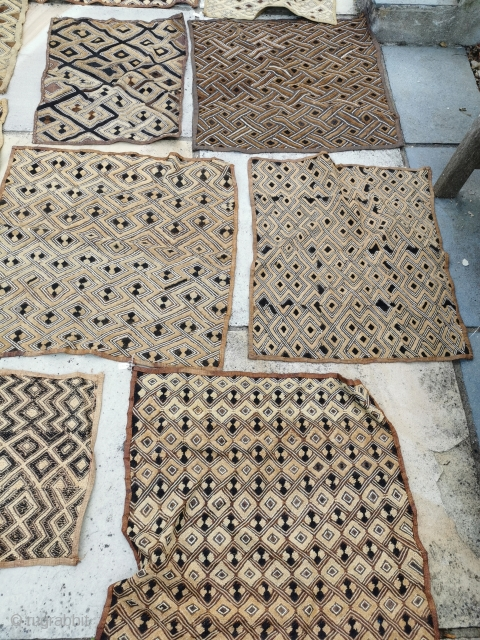 A collection of 16 raffia Kuba clothes, various ages and sizes, all in good condition