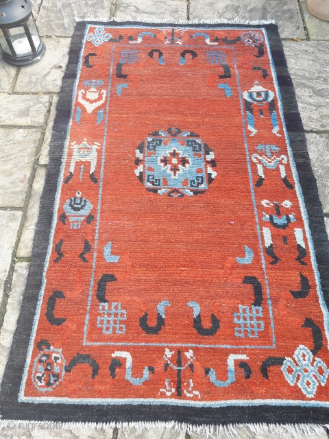 Tibetan rug, unusually large (6ft 6in by 4ft) in good condition. Cotton warps.