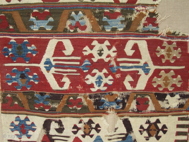 "Central Anatolian Kilim fragment..circa 1800...30""x 48""( 75cm x 122cm ) ....professionally mounted on wool.... some camelhair warps , selvedges and areas of dark aubergine wefts"