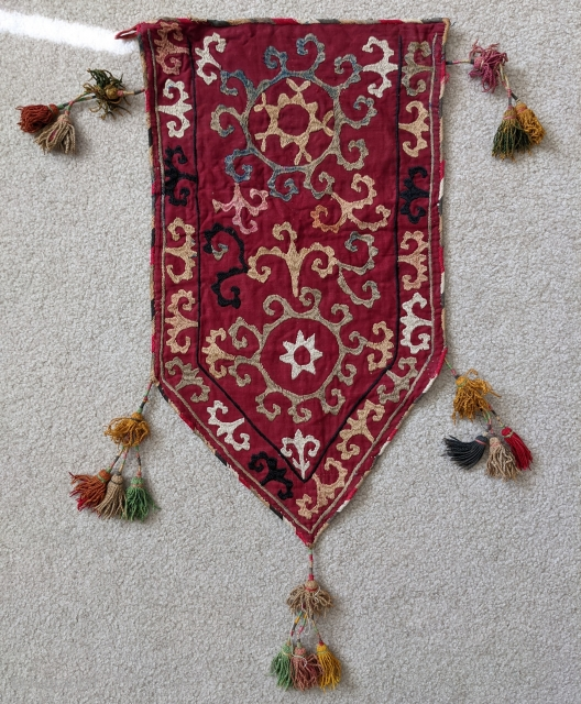 """Old Uzbek Lakai silk embroidered trapping. Beautiful piece with original silk tassles.  1'1"""" x 2'4"""" (to bottom of the lower tassle)  Cheers."""