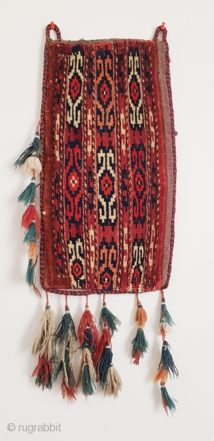 "Yomud group Igsalyk (small storage bag). Complete with backside and tassels. All natural dyes. Measures 50 x 26 cm (20""x10"")."