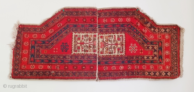 Antique East Turkestan saddle rug made of two pieces stitched together, probably Yarkand. Has very clear Turkemen design elements which is uncommon. Size is 120x54 cm (47×21 inches).