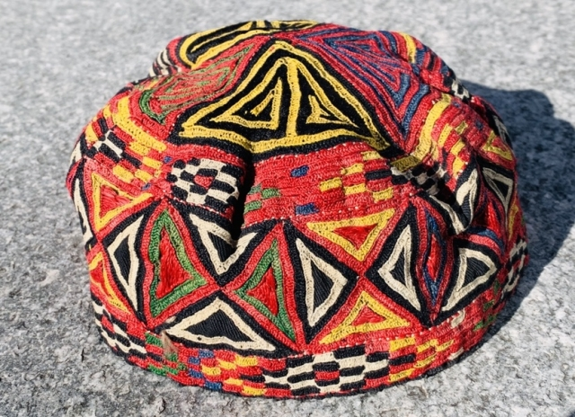 A fully embroidered hat from Central Asia. They are composed of silk embroidery on cotton and linen..