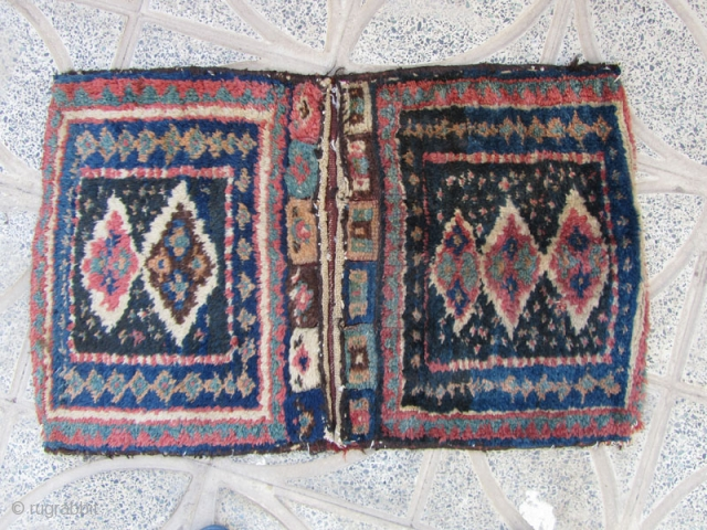Lori bakhtiari khorjin,only a tiny hole in piled place otherwise in fine condition,too dusty and not washed,Size:87 x 53 cm,with a nice back kilim