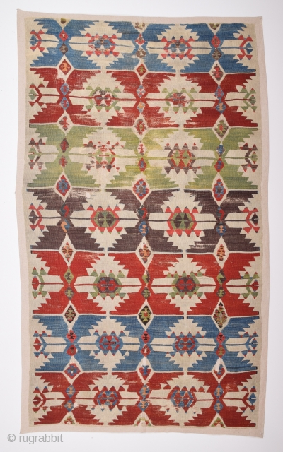 18th Century Central Anatolian Kilim Fragment size 105x185 cm mounted on linen