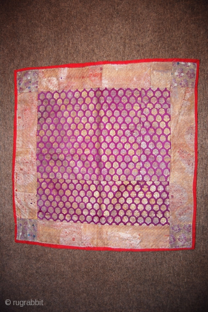 Antique Persian textile (silk brocade), sewn together from some fragments, 52 x 53 cm,backed with some red woollen fabric