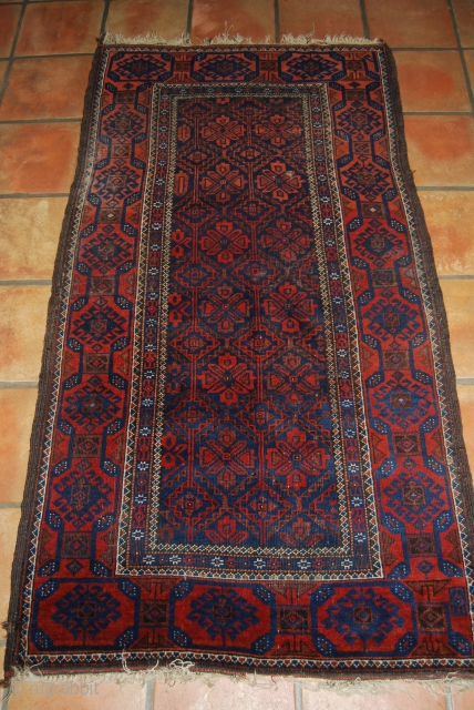 Old Baluch rug, 90 x 167 cm, traces of use and one moth bite