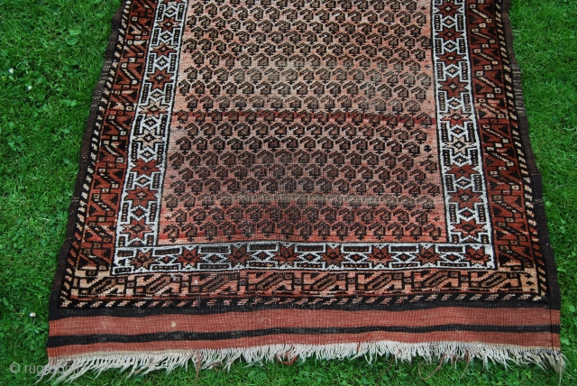 Old Baluch rug, 92 x 163 cm, condition issues with traces of use and wear, thin, but complete with small kilim ends