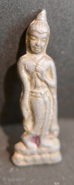 Antique Buddhist Thai Amulet...in the 'Leela' posture;  19th c. Sometimes called the 'Walking Buddha';  hugely significant amongst Thai Buddhists;  worn as a talisman to guard against harm.  Acquired from  ...