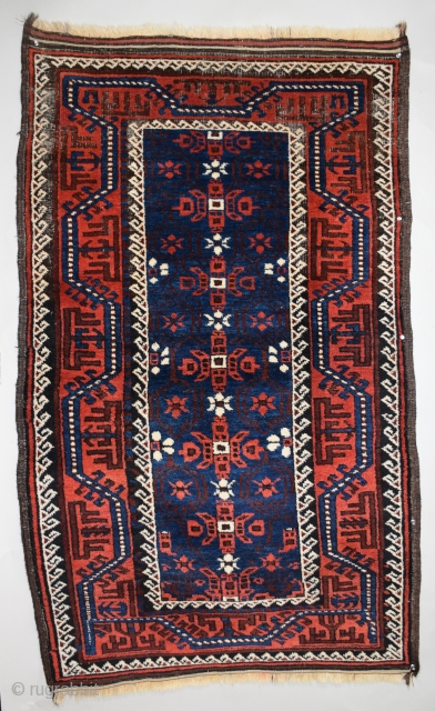 "Baluch Rug, Northeast Persia, size 37"" x 62"" (93 x 157 cm), classic Baluch design, very good condition with slight oxidation to the black in the upper border, otherwise full, lustrous pile,  ..."