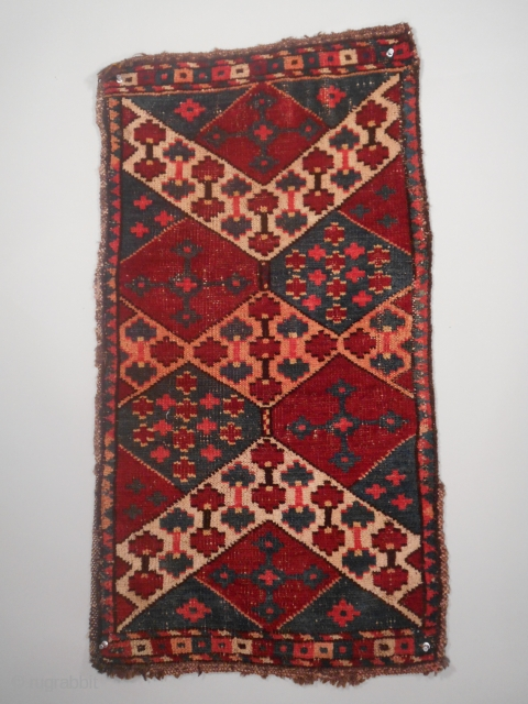 "Kungrad Chavadan Face, Kyrgyz, Southern Tajikistan, size 18"" x 35"", circa early 20th century, condition is quite good with some small areas of wear, dyes are probably synthetic but they are clear  ..."