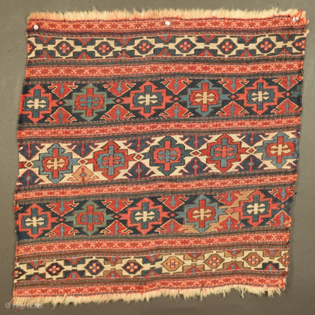 """Shahsavan end panel, Central Azarbayjan, 23"""" x 23"""", the principal design element in the three primary field panels is what Tanavoli calls an 'opposed motif', it consists of two halves that are  ..."""