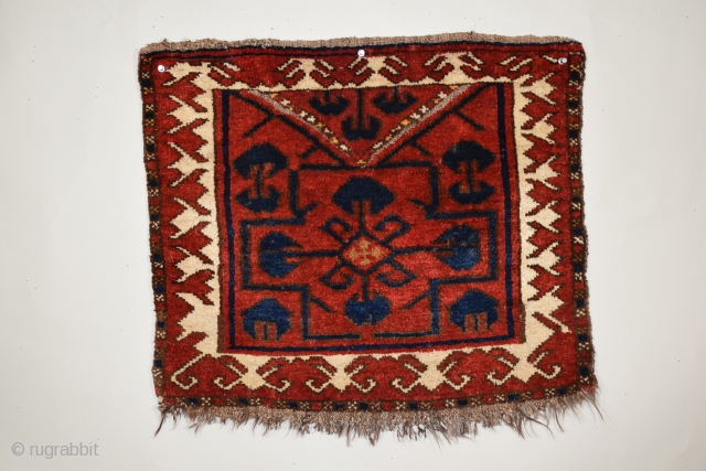 "Kyrgyz bashtyk (bag face), 24"" x 21"" (60.9 x 53 cm), this weaving displays the simplicity of design, squarish dimensions, and limited range of color typical of bashtyk of the period, the  ..."