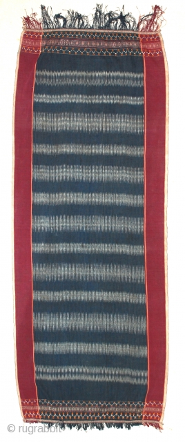 Toba Batak Textile, Sumatra,     An ulos ceremonial cloth of the Toba (Batak) people of northern Sumatra, Indonesia. Woven cotton colored blue and black with red borders and intricate  ...