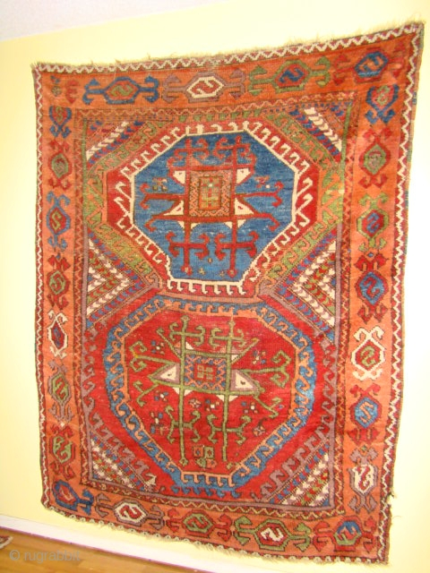 """Large Turkish Anatolian village rug with A+ colors. Size: 5'6""""X6'6"""" or 166X196 Cm Coarsely woven with generally good pile, low areas and small old repair in the red medallion as shown from  ..."""