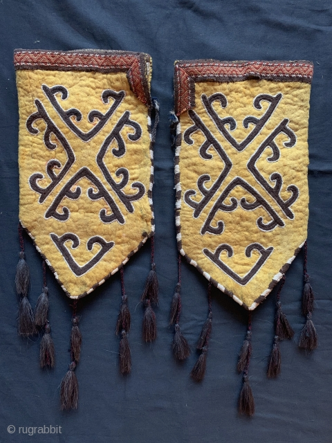 a rare pair of antique Kirghiz namad / felt embroidered Ok bash, dating between late 19th century and early 1900's . These yurt / tent textiles were possibly tent pole covers for  ...