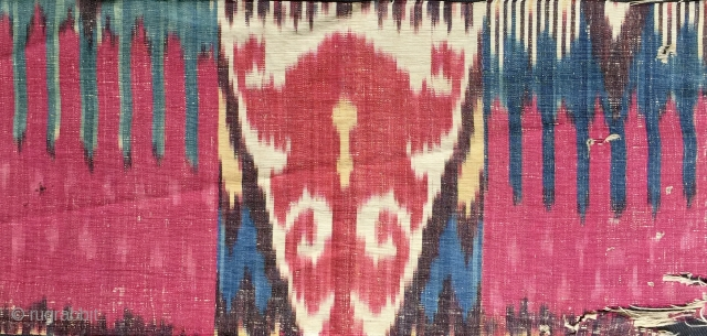 fragment of an exceptional antique Uzbek silk adras ikat from mid 19th century Bukhara. It is a silk warped on cotton weft Ikat fabric known as adras. The design is very  ...