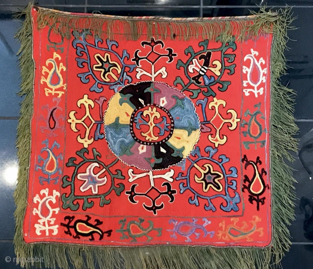 An Exceptional antique Uzbek Lakai Tribe silk embroidered Ilgich / Ayna Khalta hanging dating to the last quarter of 19th century. This particular example is very unique. The medallion with four boteh  ...