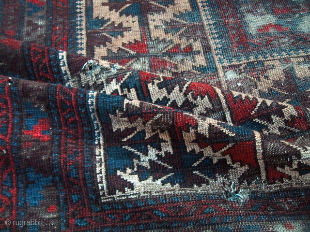 An early and archaic Belouch prayer rug with squarish format. Please ask for more details.