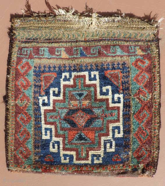 Sweet, primitive, little Baluch saddlebag half with back. 19th century.  Rich, deep indigo blues, striking turquoise hues with strong purples and warm reds.  Very tactile and endearing little piece. Size:  ...