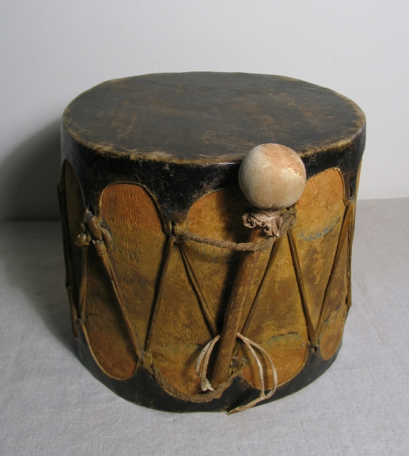 Native American cottonwood drum with original beater. 19th Century, Cochiti Pueblo, New Mexico.  An old, well made example with ceremonial paint remnants still visible. Unlike most old Native American drums this  ...