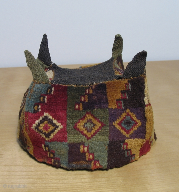 Pre-Columbian four cornered pile hat, Wari culture, AD 500 - AD 800.  Excellent, rare type with subtle, sophisticated colors and very beautiful, fine alpaca fiber.  1st rate collector piece.   ...