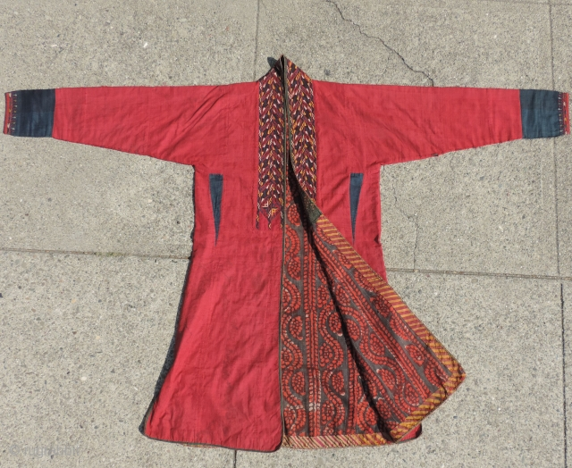 19th century Turkmen coat.  Natural dyed silk embroidery on silk ground with various block print and other fabric lining cloths.  Coat has full sleeves with cuffs not vestigial sleeves. 67  ...