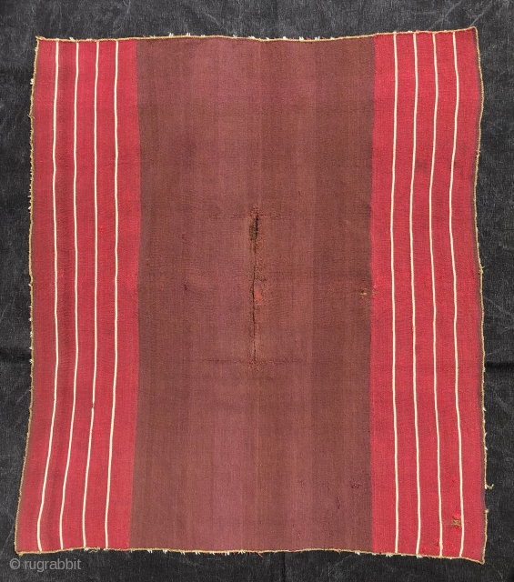 "This Aymara warp-faced plain weave (kawa-ponchito) or small poncho with a ""vacant center"" layout dates to the first quarter of the 19th century. The arrangement of the stripes and the un-patterened center  ..."