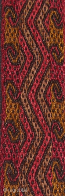 Pre-Columbian Sash, Peru, S. Coast, AD 900 - 1400.  Size: 1.25 inches x 74 inches.  Beautiful color,centipede-like design and very nicely woven.  Excellent condition.