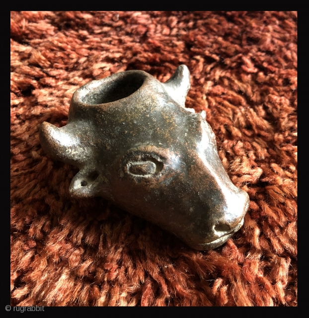 This unusual small cow head shaped ceramic is probably a variant type of libation vessel associated with the Animal Increase Rite.  I have not seen anything quite like it before.   ...
