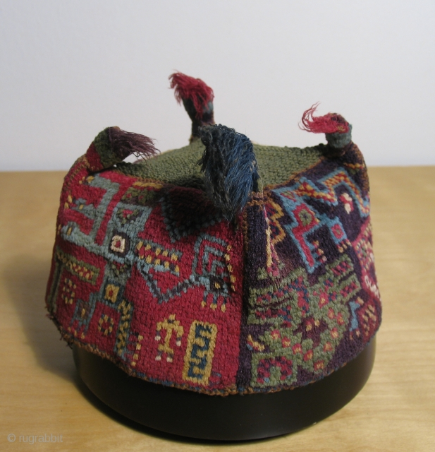 "Wari  ""four cornered"" hats have always been and still remain among the most prized Pre-Columbian Andean textile objects. Their soft lustrous pile and brilliant colors are remarkable. These hats are well  ..."