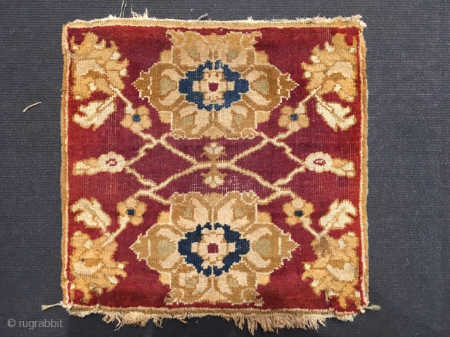 Tiny antique Agra or Amritsar mat, probably made for a campaign chair ca 1900. Size 40 x 40cm