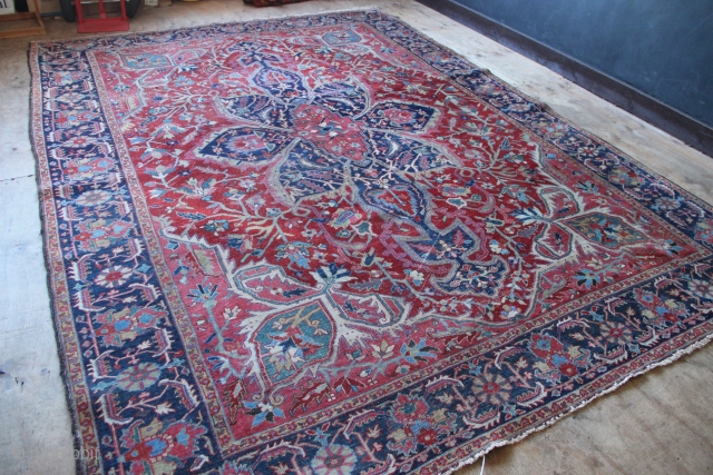 Good quality 1920's Heriz, with bold rich colour and good energy from the movement of the design. 9' x 12' Dirty, with some wear, showing foundation in places. Ends and sides ok.