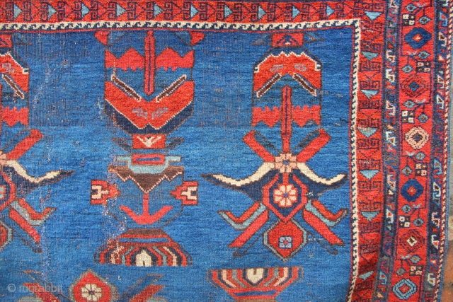 Beautiful antique Afshar, with very unusual blue sky at dawn ground colour and extraordinary stylised flowering vases repeated across the fiels. The square format promotes the graphic nature and artist quality of  ...