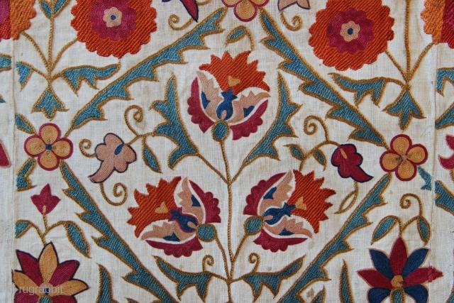 "Bokhara 'Nim' suzani circa 1850, 3'6"" x 5'0"" with original fine blue fringing and backing."