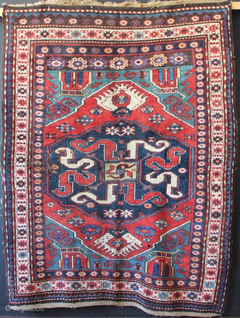 Karabagh Cloudband rug with distinct animal forms in each corner, all natural dyes. Overall very good pile, original ends and sides but dreaded moth has been at it. Several holes as well  ...