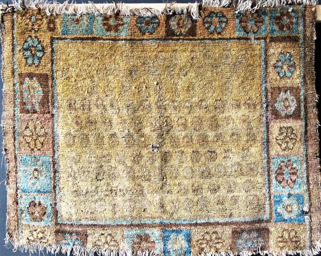 "Khotan ca 1860 3'0"" wide x 2'5"" tall. Missing top and bottom, with cotton and wool foundation. Faded fuchsine."
