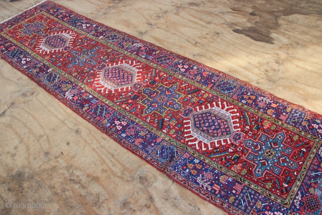 Narrow Karadja runner circa 1930 in good condition, clean and all sides secured. Pretty tomato red ground colour and mid blue border with nice touches of ivory and green  throughout. 90  ...