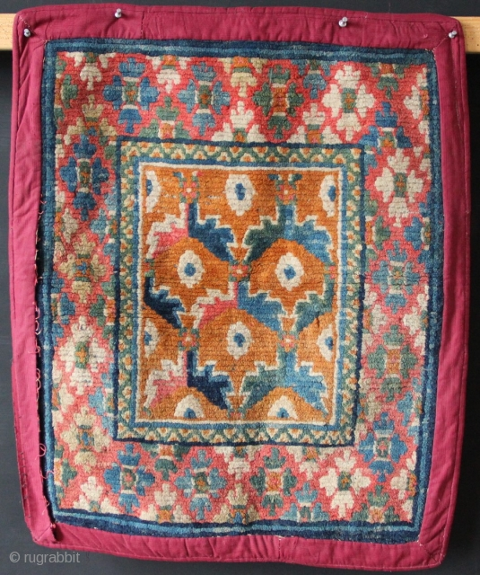 "Very pretty and unusual Tibetan sitting mat. Has an aniline red but is still an antique weave with a lot of integrity. Original edges underneath a later over-wrap. Circa 1900 2'0"" x  ..."