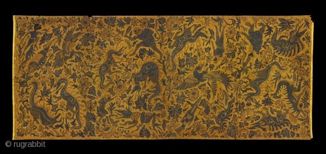 TE01812 1930s Kain Panjang Batik Tulis, long cloth hip wrapper, cotton with hand drawn wax resist pattern of comic strip Flash Gordon and dinossaur like creatures among flowering plants. Natural dyes.  Java  ...