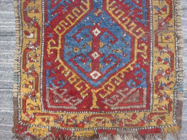 19th century Konya area yastik, 20.5 x 37 inches. Original side finish and kilim at top. Decent pile, 3 small holes.