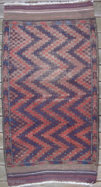 Very Unusual Antique Baluch with ZigZag Pattern.  33 x 66 inches overall. 33 x 53 inches knotted pile. Persian knotted. Upper half contains a corrosive brown. Original decorated end kilims and  ...