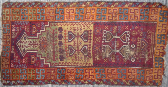 East Anatolian niche rug with Hittite swastika border