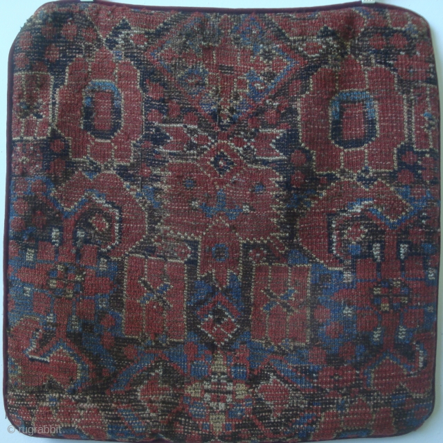 Beshir carpet fragment made into a pillow case, 22 x 22 inches. The pillow face shows the verso of this fragment from a bold Herati-pattern 19th century carpet.
