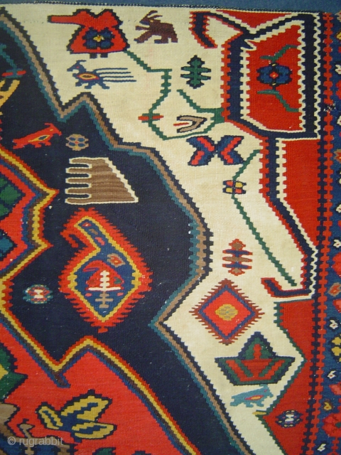 detail, Bijar small kelim featuring exotic fauna.