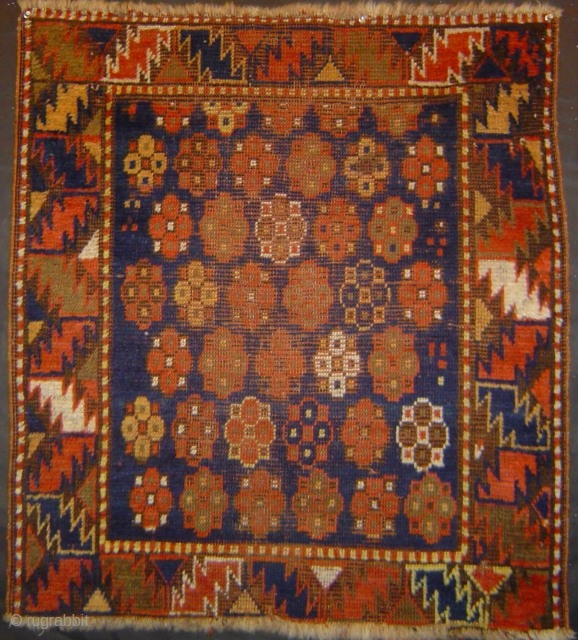 Antique Kazak small rug with 39 Rosettes and red wefts.