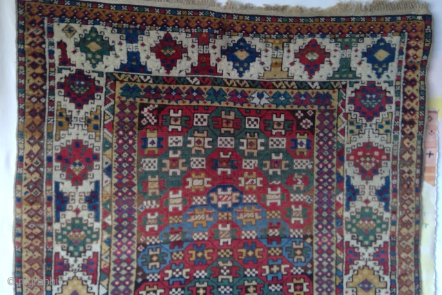 South-East Caucasus wool and camel knotted pile rug, ca. 1900 in excellent condition