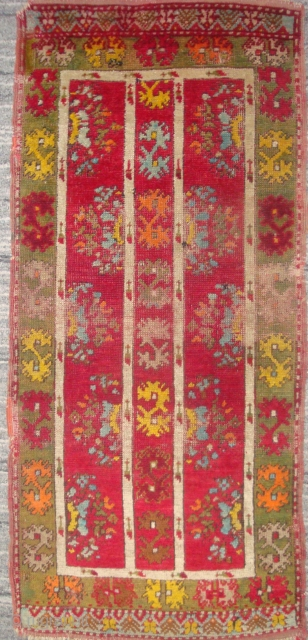 Highly unusual antique Anatolian yastik, 19 x 43 inches. I have not seen this design before. The motifs resemble those seen in North African, Moroccan embroideries. The colors have the convincing depth  ...