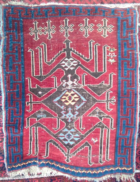 Archaic Antique Avar rug, 37 x 47 inches. Good pile, original sides and ends. Three horizontal crease slashes in field, and one vertical one at lower end. Large central motif usually seen  ...